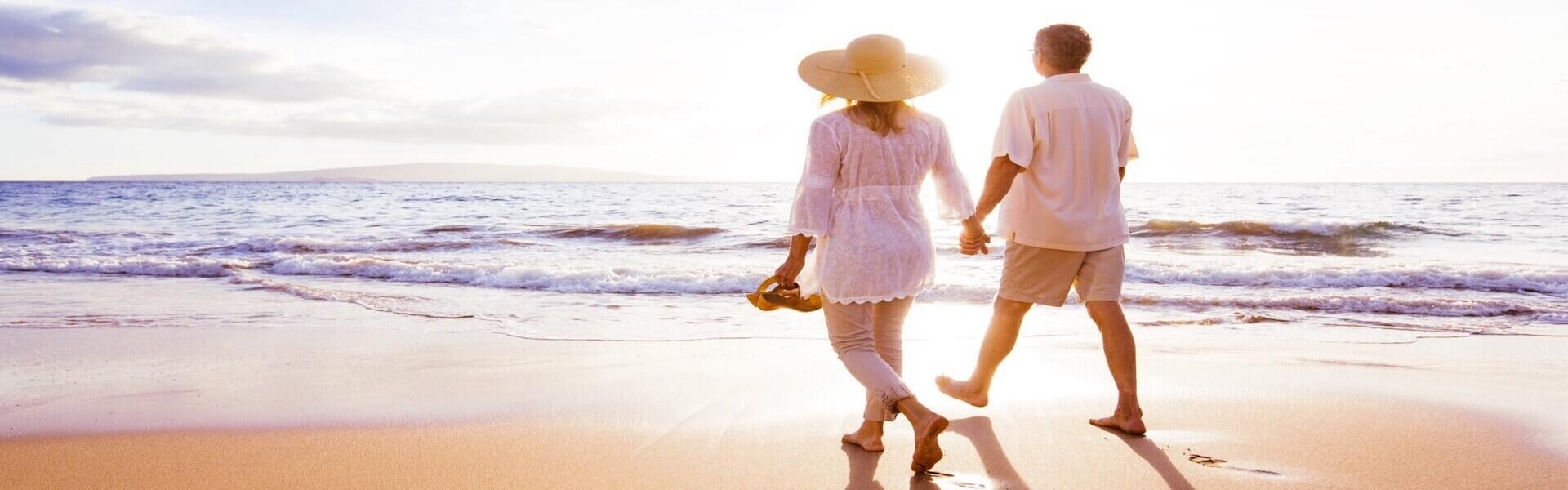 Couple walks on beach